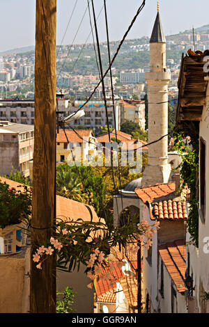 Old houses in the narrow back streets of Kusadasi Turkey - Stock Photo