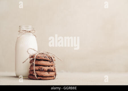 Stacked chocolate chip cookies on grey table - Stock Photo