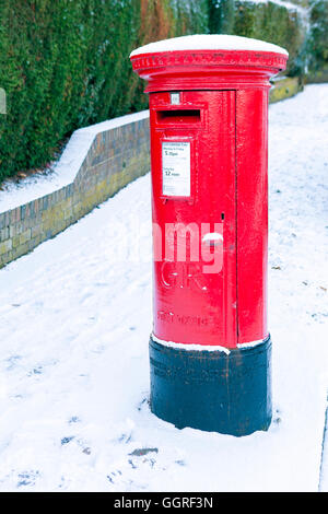 An English post box in a snowy winter - Stock Photo