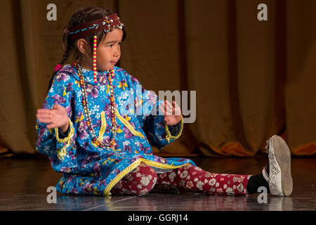 Russia, Komsomolskaya Bay, Chukotka Autonomous Okrug. Port of Provideniya. Native cultural show, young girl. - Stock Photo