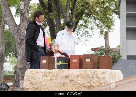 Boxes with ashes of homeless people who died on the streets of Austin TX displayed at memorial service as family - Stock Photo