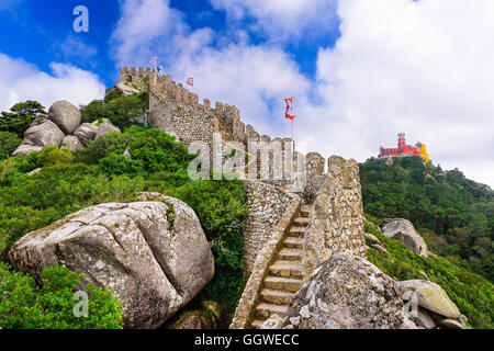 Sintra, Portugal at Castle of the Moors wall with Pena National Palace in the distance. - Stock Photo