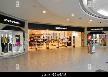 Shopping mall entrance to House of Fraser department store retail business shop front window display Intu Lakeside - Stock Photo