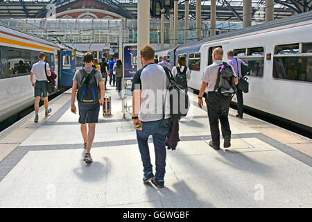 Male public transport train passengers leaving Abellio Greater Anglia trains commuting into City of London Liverpool - Stock Photo
