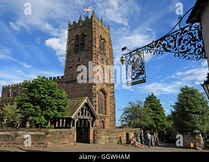 George and Dragon wrought iron sign and St Marys Church,Great Budworth,Cheshire,England, UK - Stock Photo