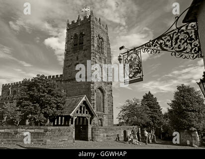 George and Dragon wrought iron sign and St Marys Church,Great Budworth,Cheshire,England, UK - Monochrome Sepia - Stock Photo
