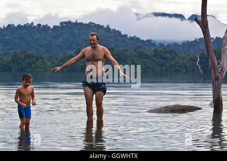 BODHI GARRETT with son BOON at the lake in KHAO SOK NATIONAL PARK - THAILAND - Stock Photo