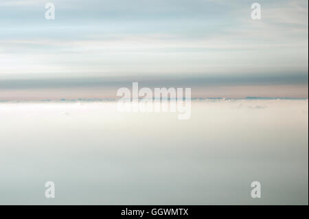 Cloudy Sky background beautiful scenery with natural soft colors Aerial view from mountain summit - Stock Photo