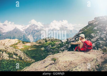 Woman Traveler with backpack relaxing with mountains serenity view Travel Lifestyle concept hiking adventure summer - Stock Photo