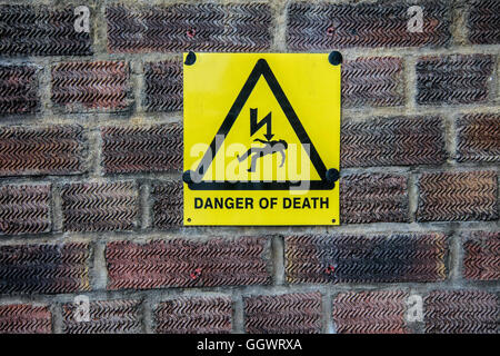 'Danger of Death' sign on brick wall - Berkhamsted, UK - Stock Photo