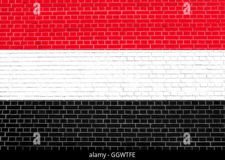 Flag of Yemen on brick wall texture background. Yemeni national flag. - Stock Photo