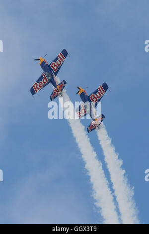 The Red Bull aerobatics team performing at the America's Cup World Series 2016 event in Portsmouth, UK - Stock Photo