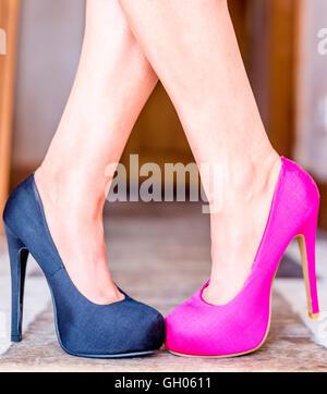 A woman wearing odd shoes - Stock Photo