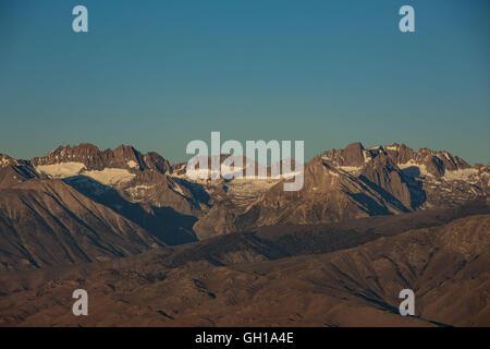 Jun 14, 2014 - White Mountains, California, U.S. - The Sierra Nevada mountains and Mount Whitney seen at sunrise - Stock Photo