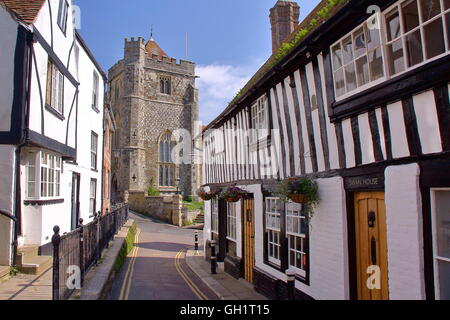 16th century timbered framed and medieval houses with St Clement Church in the background, Hastings, Sussex, Great - Stock Photo
