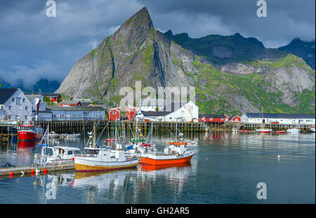 Reine, Lofoten Islands with sea and surrounding mountains - Stock Photo