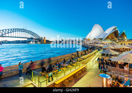People dining at outdoor restaurants in Circular Quay in Sydney, Australia - Stock Photo
