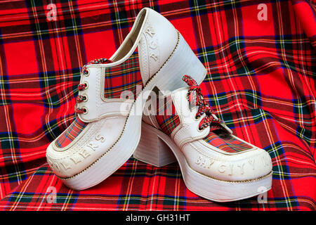'Used' pair of 'Bay City Rollers' fashion shoes, from 1970's. bay City Rollers was a Scottish pop group famous for - Stock Photo