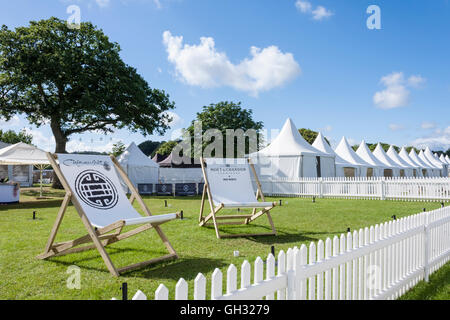 Giant deck chairs outside Corporate Hospitality tentage at Henley-on-Thames regatta, Oxfordshire, England, GB, UK. - Stock Photo