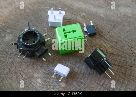 A traveler's collection of international adapter plugs - Stock Photo
