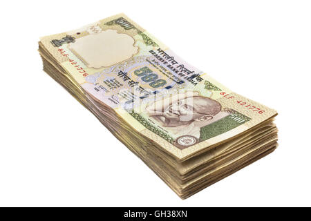 A stack of five hundred rupee notes (Indian currency) isolated on a white background. - Stock Photo