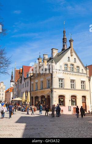 Tallinn, Estonia - May 2, 2016: Old Tallinn street view with walking tourists and ordinary people - Stock Photo