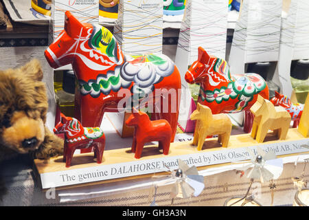 Stockholm, Sweden - May 5, 2016: Wooden toy horses, popular Swedish souvenir on the counter of touristic shop - Stock Photo
