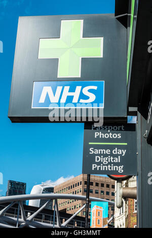 London, England, UK: NHS and Green Cross sign in London, UK - Stock Photo