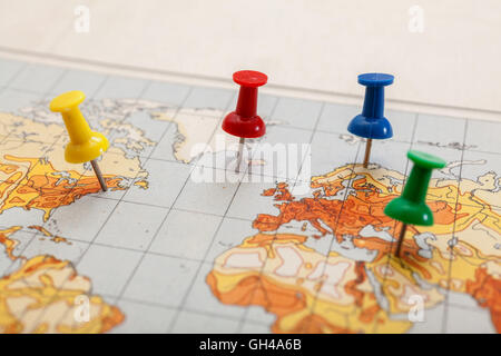 Push pins showing the location of a destination point on a temperature map - Stock Photo