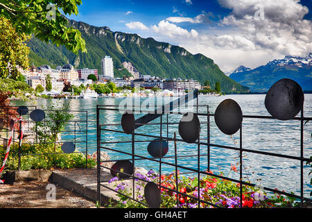 Lakeshore View of Lake Geneva at Montreux with Musical Notes Fence, Vaud Canton, Switzerland - Stock Photo