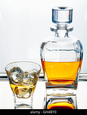 Smooth Scotch Whiskey in Traditional Decanter and Glass with Ice Cubes - Stock Photo