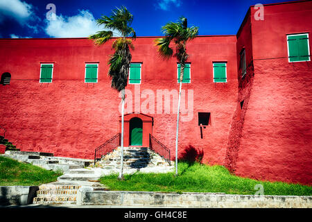 Low Angle View the Red Walls and Green Shutters of Fort Christian, Charlotte Amalie, St Thomas, US Virgin Islands - Stock Photo