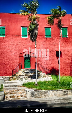 Close Up View the Red Walls and Green Shutters of Fort Christian, Charlotte Amalie, St Thomas, US Virgin Islands - Stock Photo