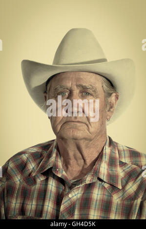 Cowboy with the years of experience written in the lines of his face. Retro instagram look - Stock Photo