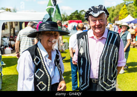 Pearly King & Queen Kings and Queens known as pearlies are an organised charitable tradition of working class culture - Stock Photo