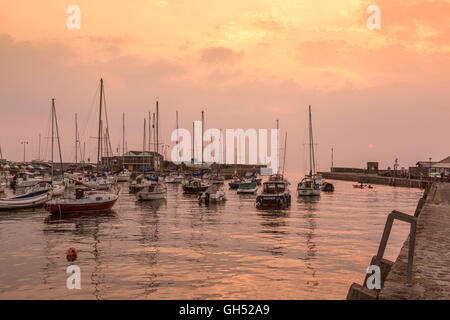 A summer sunset in the harbour at Aberaeron, Ceredigion, Wales, UK - Stock Photo