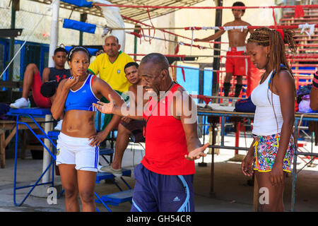 Boxing coach Nardo Mestre Flores trains young boxers at the famous Rafael Trejo Boxing Gym in Havana, Cuba - Stock Photo