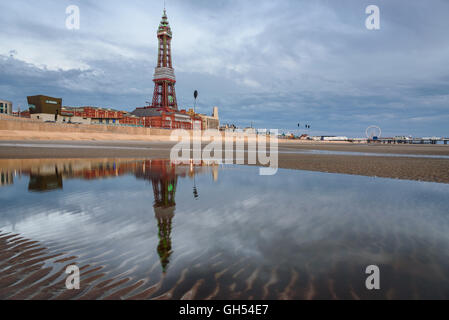 Reflection of Blackpool tower in the pond of water on the beach. - Stock Photo