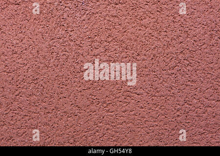 Burgundy red painted stucco wall. Background texture. - Stock Photo