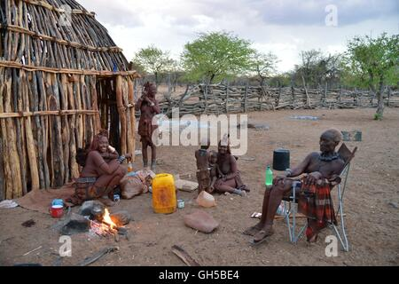geography / travel, Namibia, chief Hikuminue Kapika, of the chief of the Namibian Himba, with his family at fire - Stock Photo
