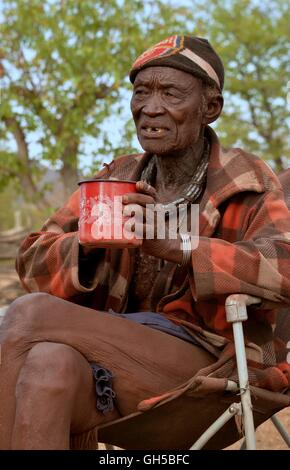 geography / travel, Namibia, chief Hikuminue Kapika, of the chief of the Namibian Himba, in his kraal near the village - Stock Photo
