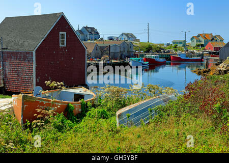 Peggy's Cove, Nova Scotia, Canada showing fish shacks and lobster boats in summer - Stock Photo