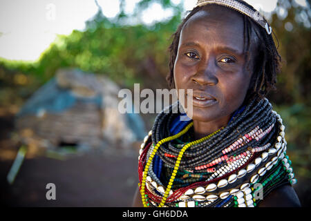 Woman from Nyangatom (Bume) Tribe in Ethiopia. - Stock Photo