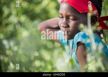 Daydream - Young Girl from Nyangatom (Bume) Tribe in Ethiopia. - Stock Photo