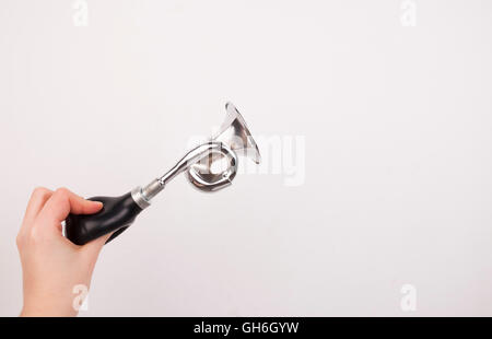 Hand holding the vintage manual air horn on white background. - Stock Photo