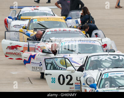 Classic Racing And Sports Race Cars In A Queue Wait To Join The