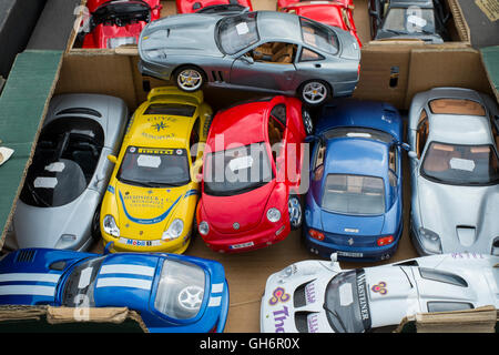 A box of model cars for sale on a stall at the 2016 Silverstone Classic meeting, Northamptonshire, England, UK - Stock Photo