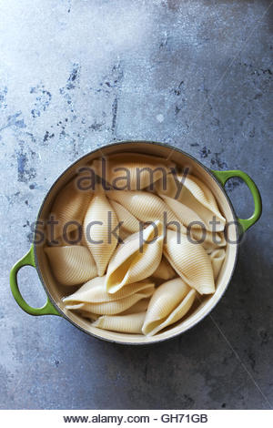 Cooked conchiglie pasta in a pan.Top view. - Stock Photo