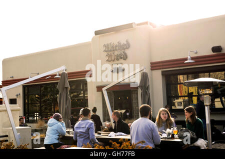 People enjoying the outside deck at Wicked Weed Brewery in Asheville, North Carolina - Stock Photo