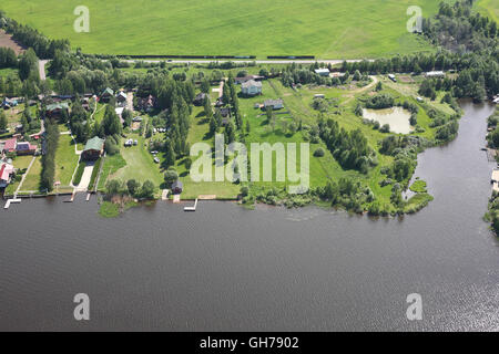 Aerial Views - Russia. Houses, moorings and other constructions on the river bank Volga. Shooting from the helicopter. - Stock Photo